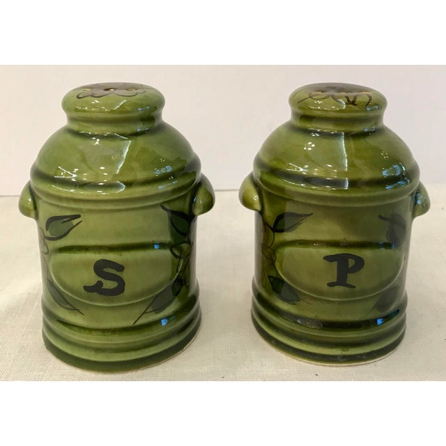Beautiful green hand painted ceramic salt and pepper shakers. Marked Deforest Of CA. USA