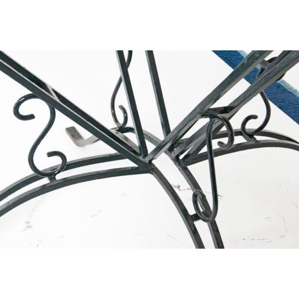 Wrought iron green garden table from France, circa 1920. Ex collection of Thomas Church. Original top lacking. Chic,...