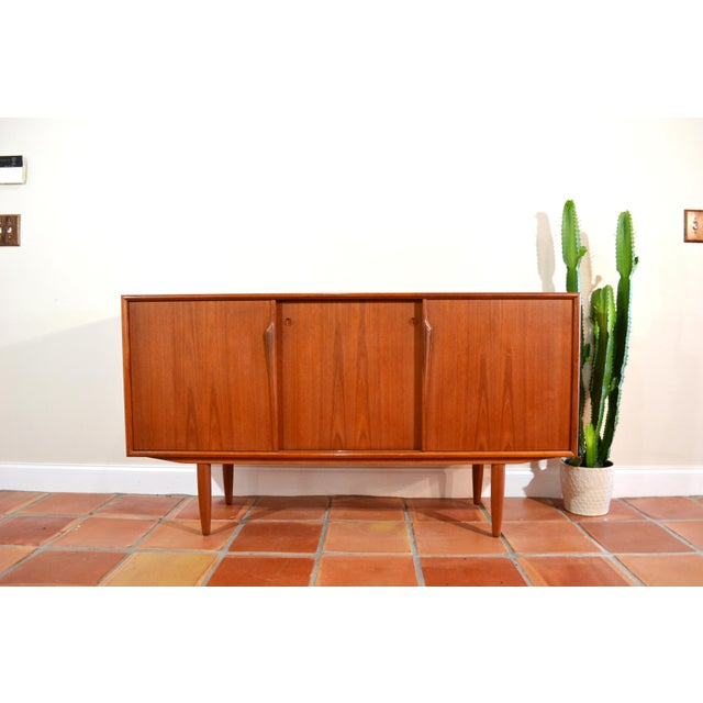 Danish Teak Credenza by Gunni Omann. Beautiful teak grain. Back was replaced. 3 small drawers on left and one open cabinet...