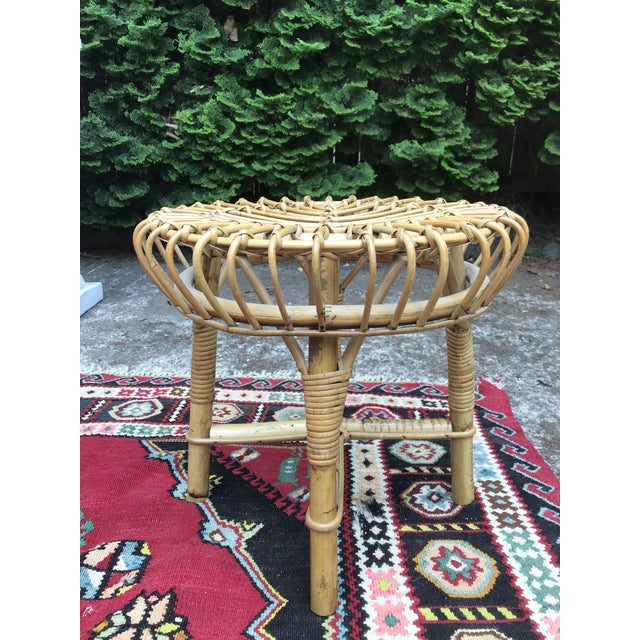 Great rattan mid century foot stool or ottoman. In the style of Franco Albini, very good condition with no breaks.