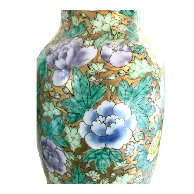 Absolutely stunning pair of Chinoiserie floral Vases . Gold metallic background with pastel yellow pink purple flowers....