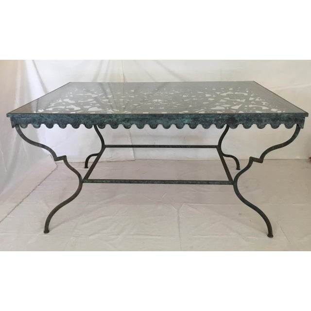 This spectacular Iron Table with classic lines shows beautiful scroll work with flowers blooming throughout! The rounded...