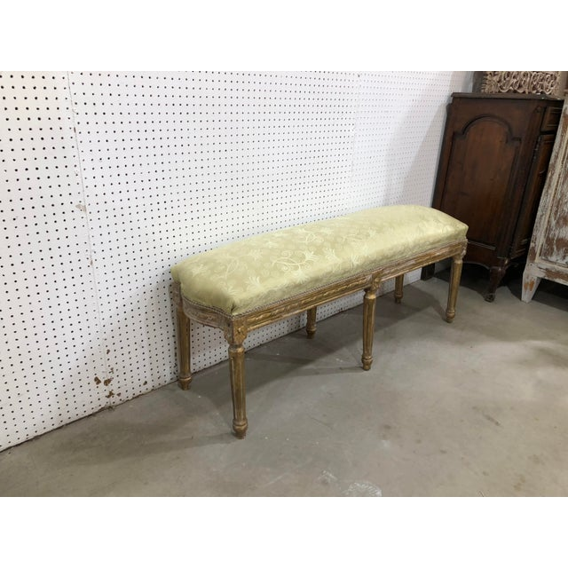 Extremely ornate stunning long bench imported from france. Solid Oak giltwood covered in light green paisley linen....