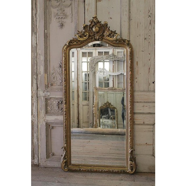 This stunning and very impressive gilt French mirror is of exceptional quality. Styled in the Louis XV fashion, the mirror...