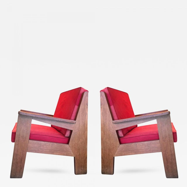 Pierre Jeanneret attributed pair of oak modernist chairs with striking design.
