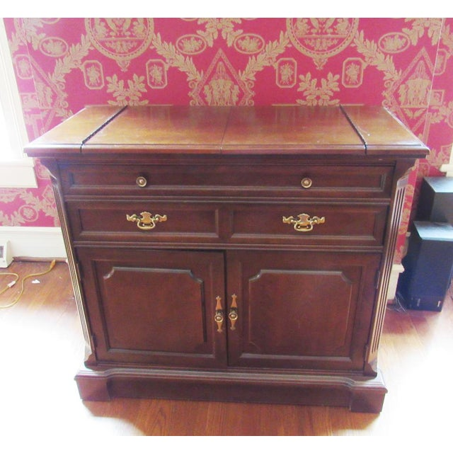 Need more surface area when entertaining? This fine cherry flip top server by Bassett will solve your problems. -...