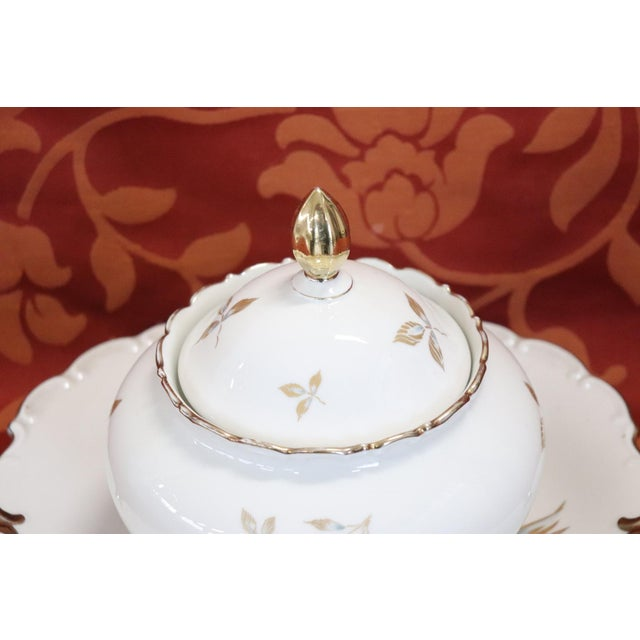 Beautiful hand painted and gold porcelain centerpiece by J Seltmann Bavaria 15 pieces, 1940s. The service is complete of...
