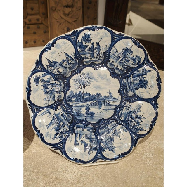 These unusual antique faience bowls or platters have nine formed, segmented scenes within cartouches. They are quite...