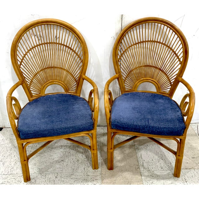 1970s Bamboo & Rattan 'Sunrise' Armchairs- a Pair Each one with finely woven reed and willow stylised back of three tier a...
