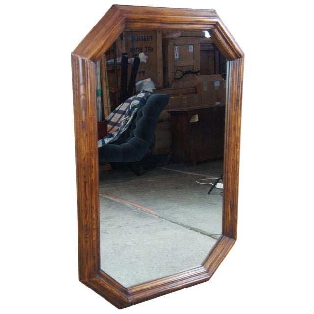 1979 Henredon octogon shaped mirror. Made from oak with traditional styling.