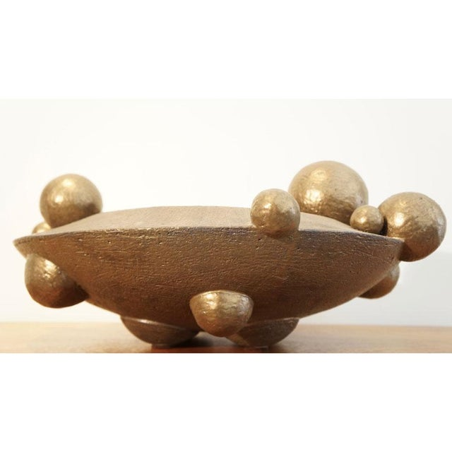 This is a bronze orb vessel. This listing is for a bronze clay glazed sculpture.