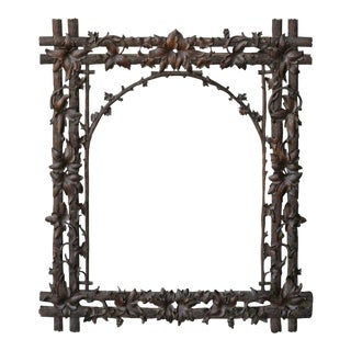 German 1900s Black Forest Carved Wood Mirror with Branches and Vine Leaves