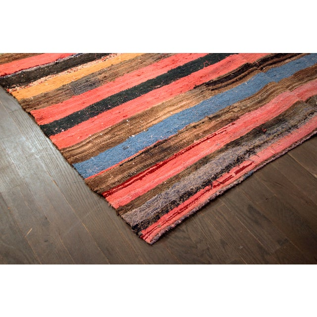 A vintage hand-woven Turkish cotton kilim rug, with a panelled colorful stripe design. It would be perfect as a large...