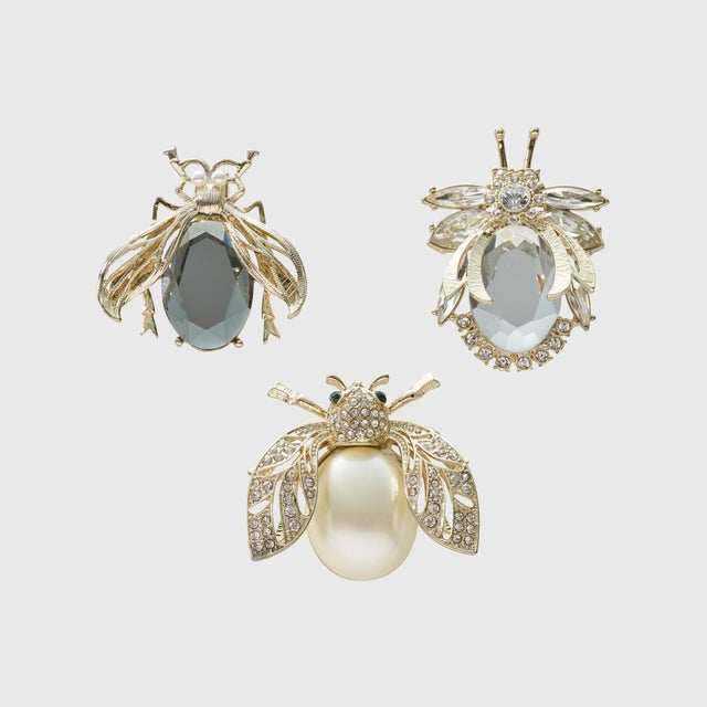 Classic glamour and sparkle need we say more? Clip them to a bridal bouquet, an orchid or add a little dazzle to the top...