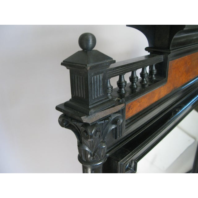 A very handsome 19th century standing cheval mirror, with an ebonized frame and burlwood accents. Beautiful details,...