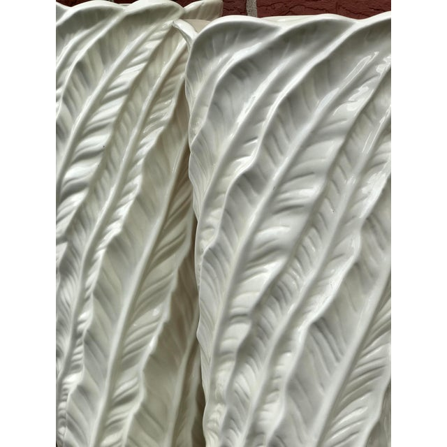 Vintage pair of Palm Beach style creamy white ceramic mantel / table/ floor vases. Tropical palm leaf molded design wraps...