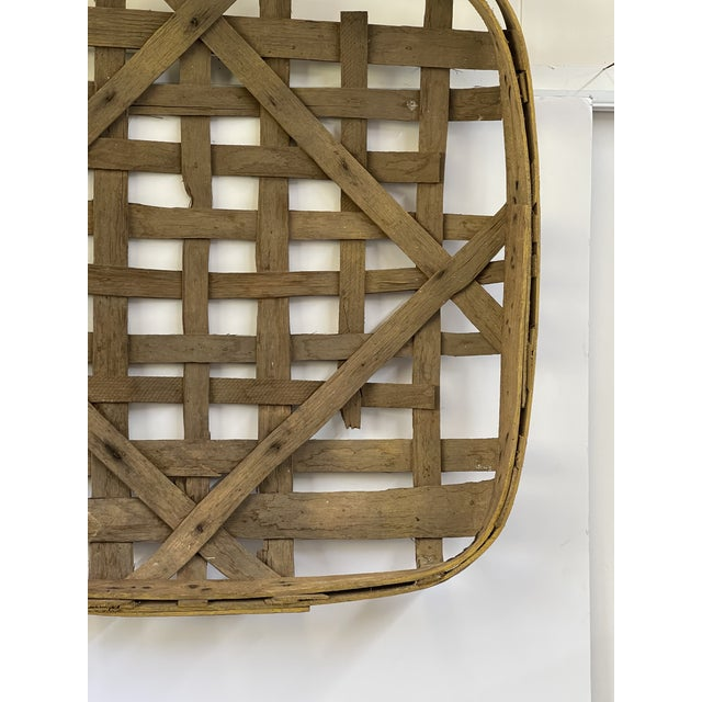 Large authentic handmade tobacco basket nicely woven and weathered with a painted yellow frame stenciled with Columbia,...