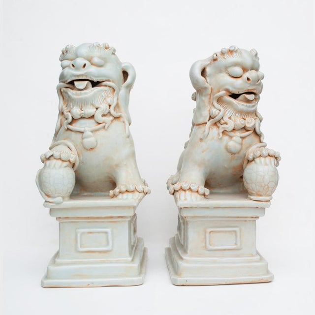 """Beautiful pair of large, 13"""" tall Chinese celadon porcelain Foo Lions or Foo Dogs holding balls, decorated with flowers...."""