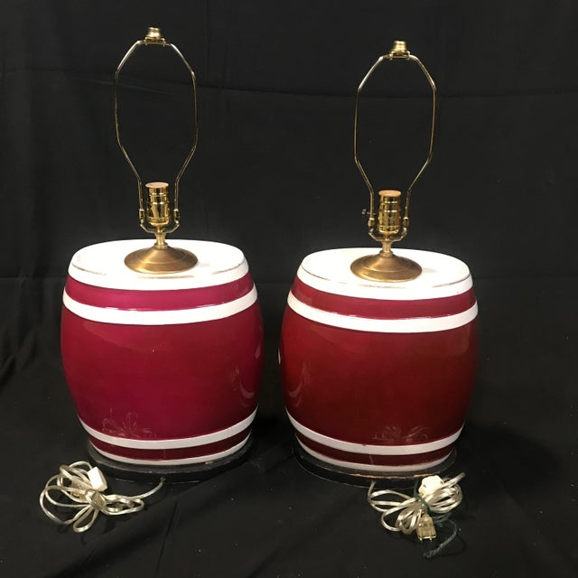 Pair of eye-catching English ceramic spirit barrel lamps, gin and Irish whiskey, in a wonderful dark red and white with...