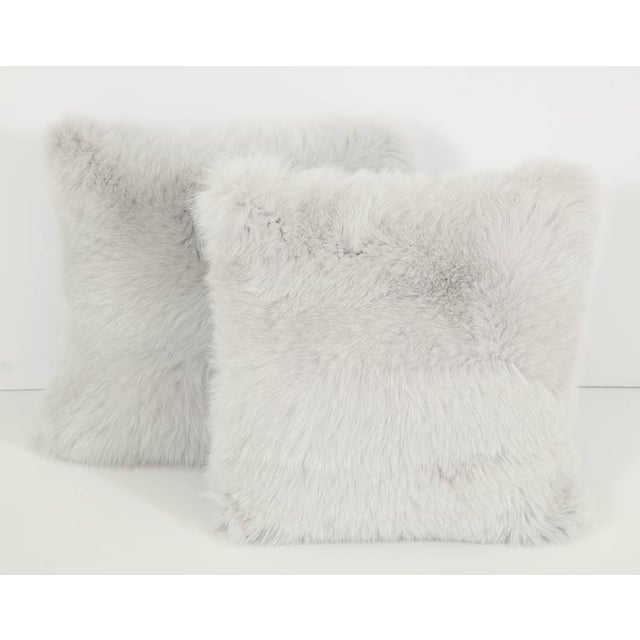 Add a bit of glamour to a room with this pair of fox fur pillows in a silvery white, backed in a lovely soft blue.