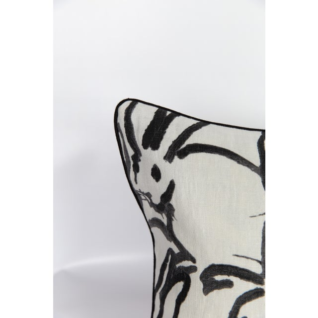 Custom lumbar 14x34 pillow made from a linen blend bunny-pattern textile with a solid ivory linen blend back and...