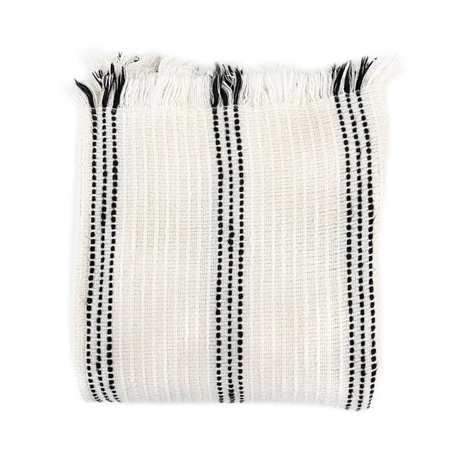 Create warm memories and invite sustainable values into your home with our striped throw blanket. This throw blanket is...