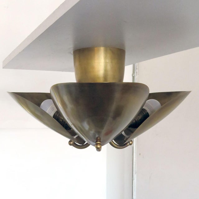 Wonderful, organic three-petal patinated brass flush mount by Gallery L7. Made to order, lead time 2-3 weeks. Priced...