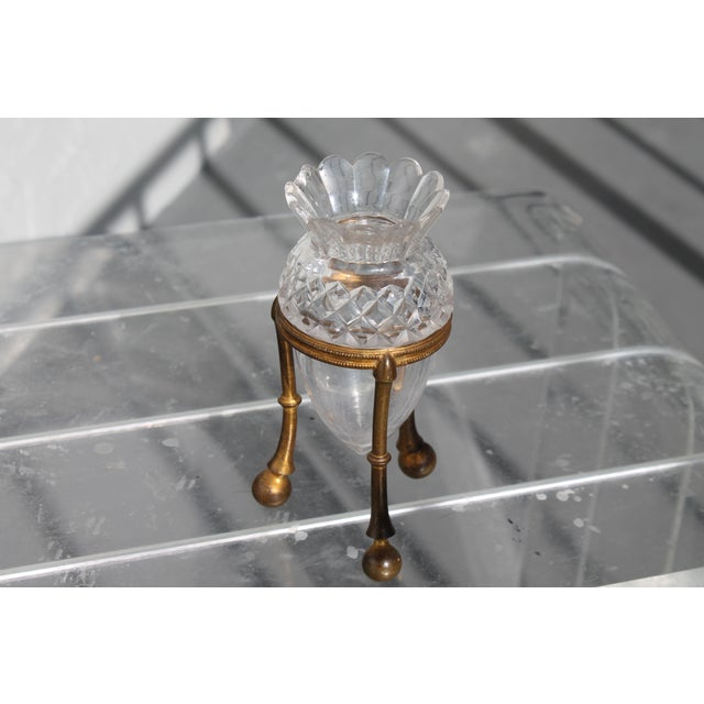 A beautiful tri legged Cut Crystal and Gilt Bronze Based Petite Signed F & C Osler Epergne. Very tiny chip on one of the...