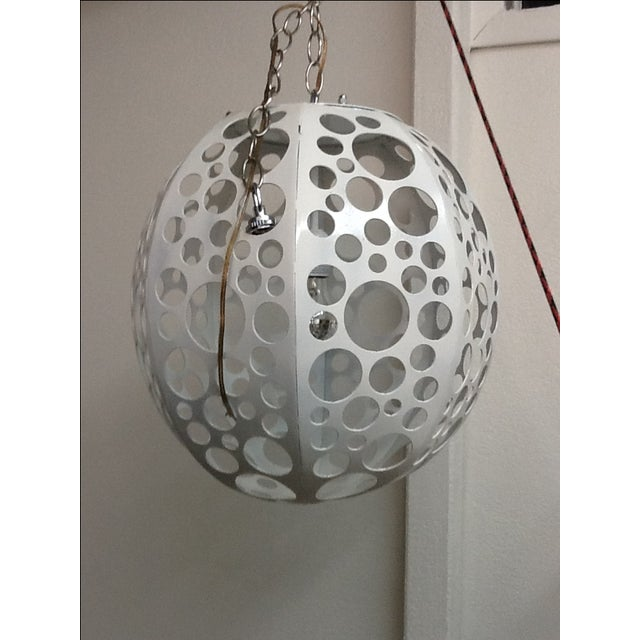Mid-Century pendant light. Has been restored and rewired, is in excellent condition.