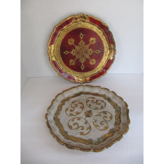 Set of two vintage Florentine trays, one off white and gold and the other dark red and gold. Great on a vanity, to serve...