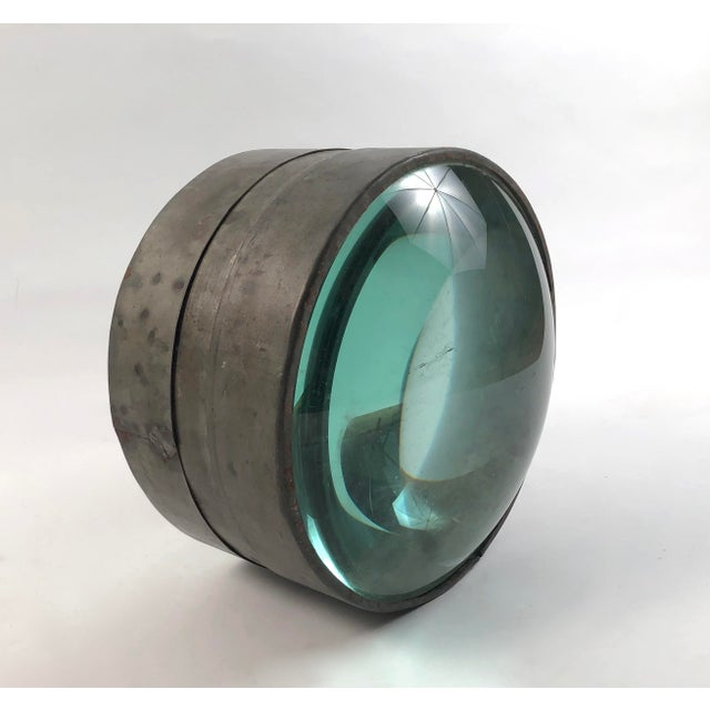 A rare 19th century light house lens, American, circa 1880s, the 2 magnifying convex glass elements contained in a tin or...