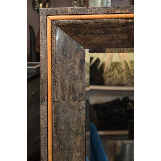 Large custom coco shell veneer and orange stained parchment mirror.