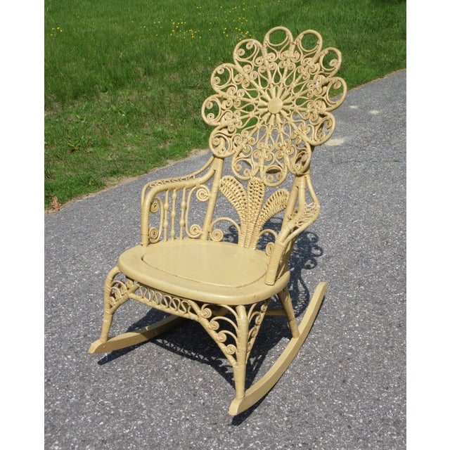 American Victorian natural wicker ornate high back rocking chair with stick and ball fretwork supported arms, floral...