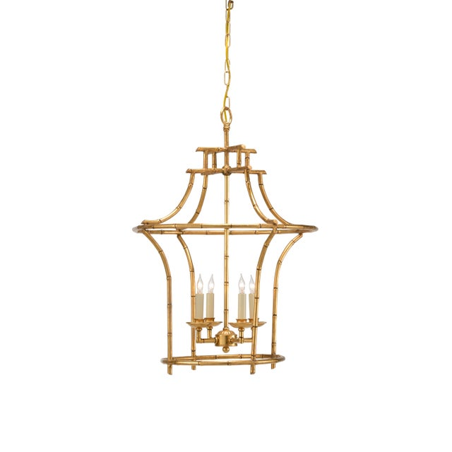 This is a chandelier by Chelsea House Inc. The piece features an antique gold faux bamboo frame.