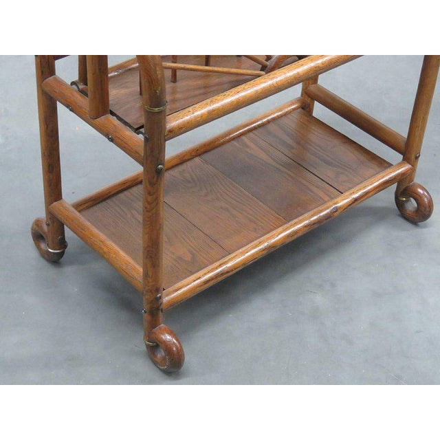 Victorian bentwood oak magazine rack with brass accents.