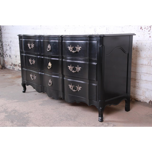 An exceptional French Provincial Louis XV style triple dresser or credenza by John Widdicomb. The dresser features...