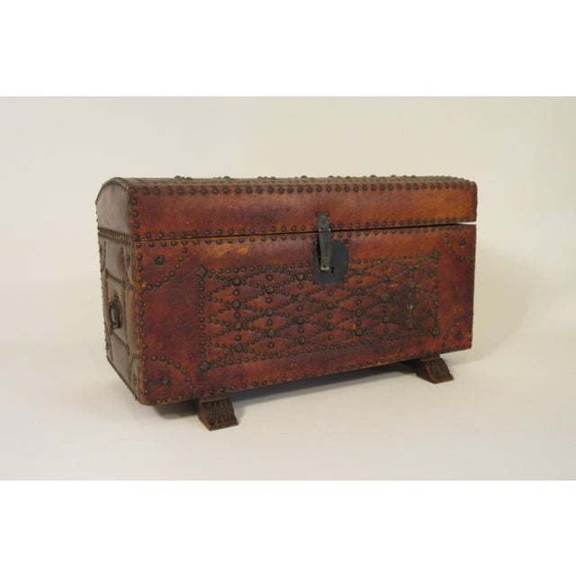1950s leather studded dome top trunk.