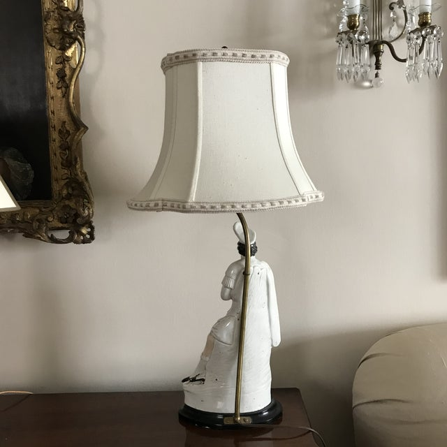 Rare and hard to find beautiful Staffordshire lamp mounted on black painter wood base. The designer lampshade is fully...