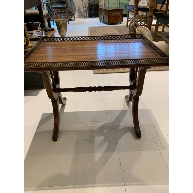 """Graceful and elegant mid-century side table with lyre motif, brass """"hairy paw"""" fittings on feet and delicate carved brass..."""