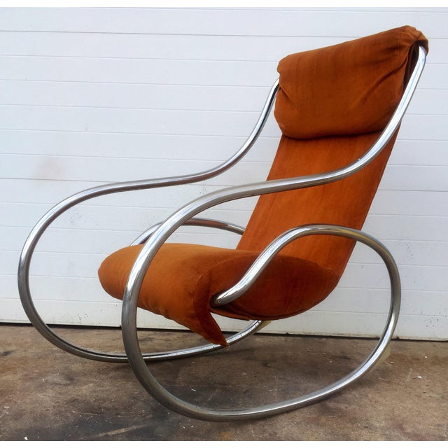 This listing is for a vintage Jerry Johnson Chrome rocker. Needs to be re-chromed and re-upholstered.