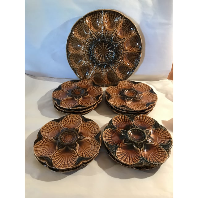 Beautifully cared for, this huge midcentury oyster set of majolica by Sarreguemines is offered in tones of brown. The...