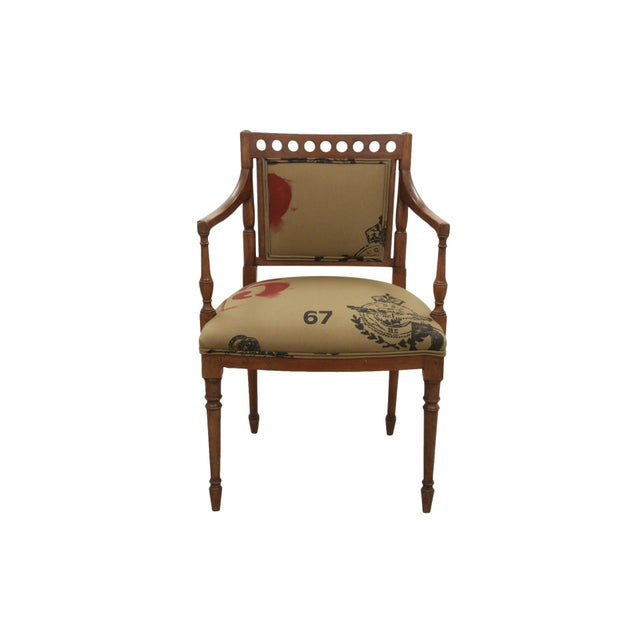 A Sheraton style accent chair made of maple, newly upholstered in Ralph Lauren's Airforce fabric in Khaki. Decorated with...