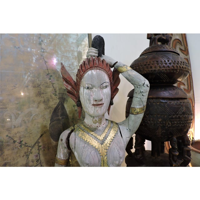 Mid 19th Century Carved Wooden Statue of Phra Mae Therani, the Thai Earth Mother Goddess Wringing the Cool Waters of Detachment Out of Her Hair For Sale - Image 5 of 7