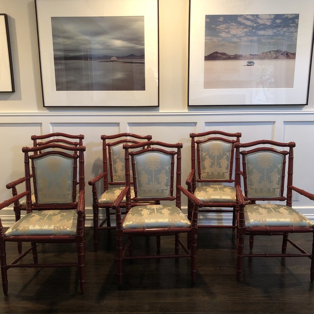 Lacquered dark red faux bamboo armed chairs with celadon chinoiserie fabric.