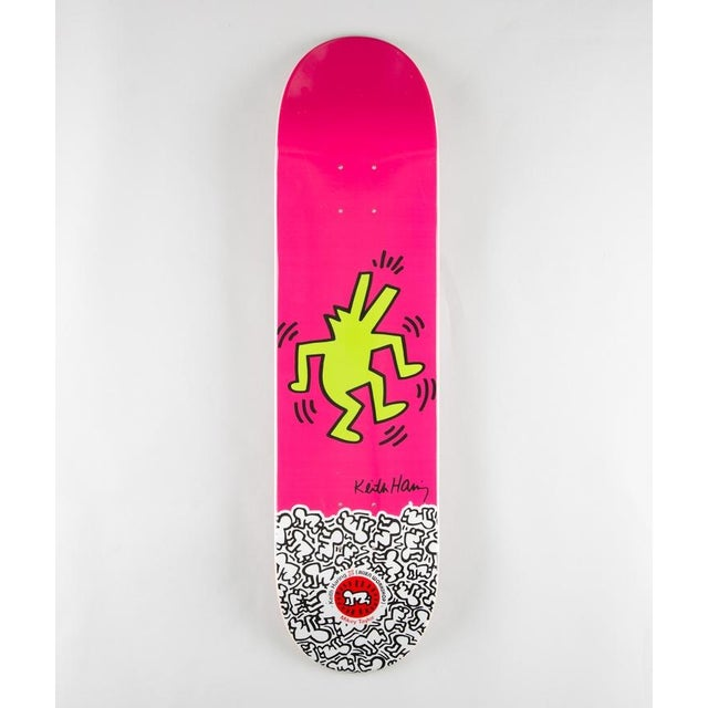 This limited edition Keith Haring skateboard deck is new and remains in its original shrink wrap. It is silkscreen on a...