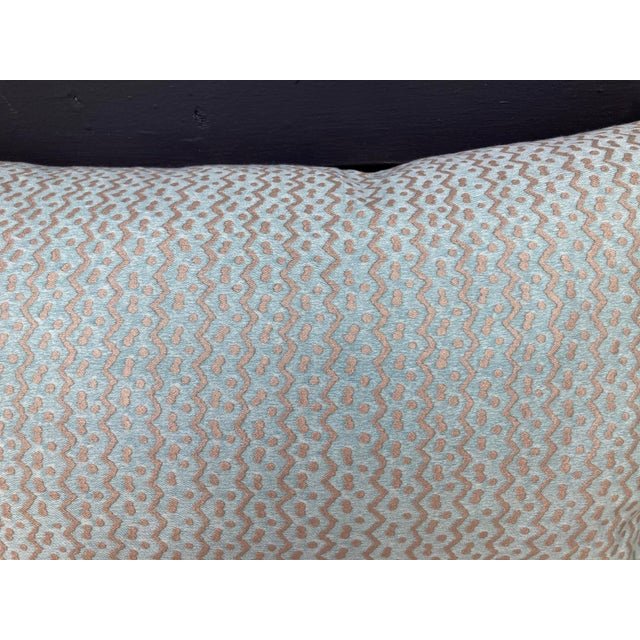 A pillow made from Fortuny's iconic hand printed cotton, backed with coordinating silk velvet, a down insert is included.