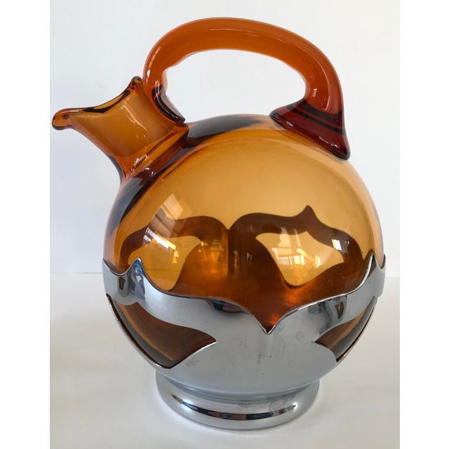 Beautiful set of Amber crystal & chrome glasses and decanter. Made between 1932-1965 by Farber Bros. All pieces in...