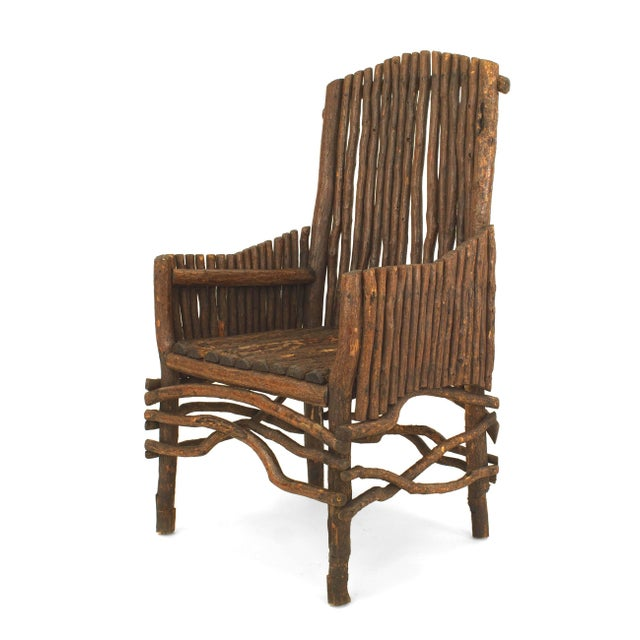 American Rustic Adirondack (1st qtr 20th Cent) slat twig design arm chair with an arch form high back and solid slat twig...