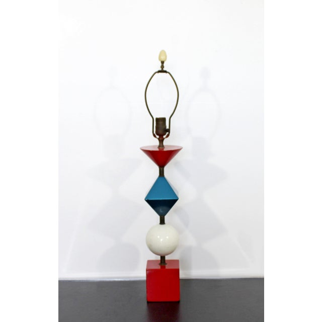 For your consideration is a stunning, multicolored table lamp, made of stacked shapes and with its original finial, by...