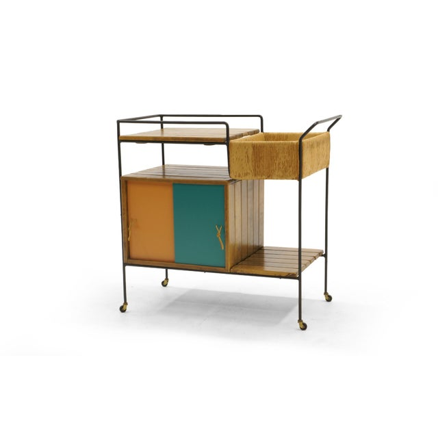 Bar Trolley by Arthur Umanoff. The sliding Masonite doors also have a white and blue side. This is a Fine example in...